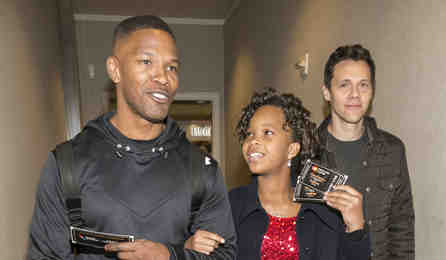 Jamie Foxx escorts Quvenzhané Wallis and Annie director Will Gluck on board an American Airlines flight to give passengers a Priceless Surprise from MasterCard