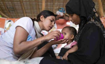 UNICEF Goodwill Ambassador Priyanka Chopra helps feed a Rohingya refugee baby at a UNICEF-supported therapeutic feeding center for malnourished children.in Jamtoli camp, Cox's Bazar district, Bangladesh on 23 May 2018. Photo: UNICEF